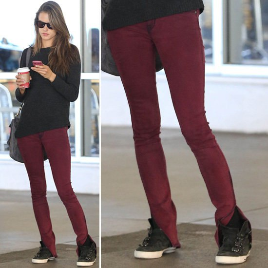 black knit sweater burgundy skinny jeans