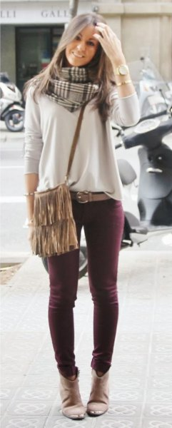 white casual fit sweater burgundy skinny jeans