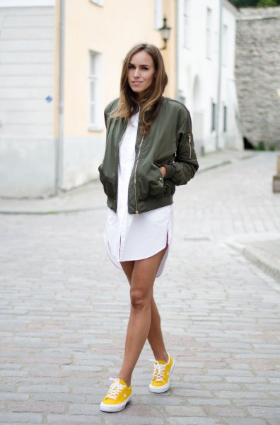 yellow sneakers white shirt dress green bomber jacket