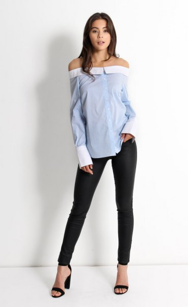 of shoulder-blue striped sweater black skinny jeans