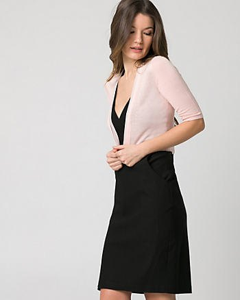 white half-sleeved bolero jacket black deep v-neck dress