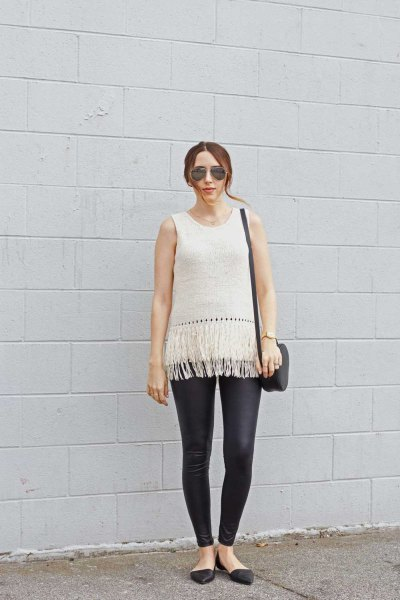 white sleeveless knitted sweaters in black leather leggings