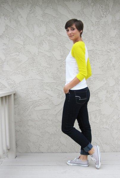 yellow and white baseball shirt black skinny jeans