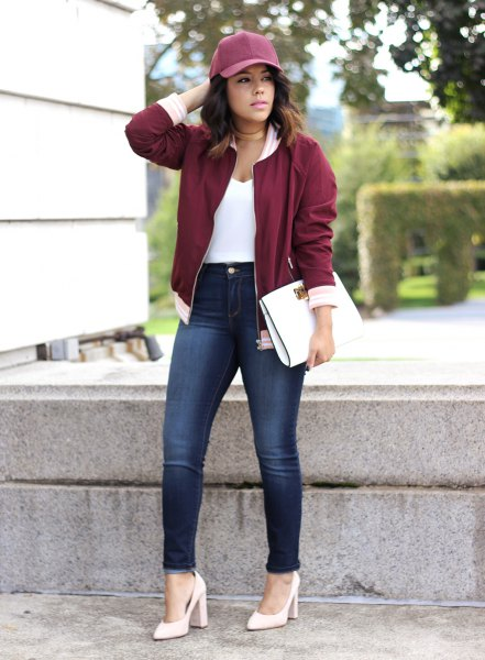 maroon jacket white pointed toe pumps gray baseball cap
