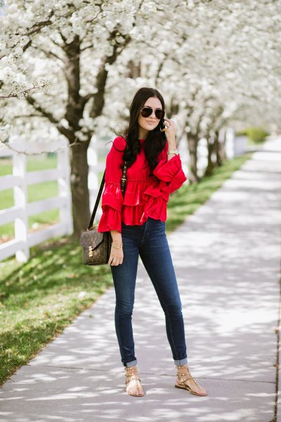 red comfy blouse cuffed skinny jeans