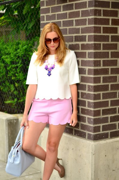 white half-heated t-shirt neon pink peeled mini shorts