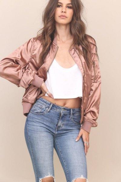pink gold bomber jacket black harvest vest ripped jeans
