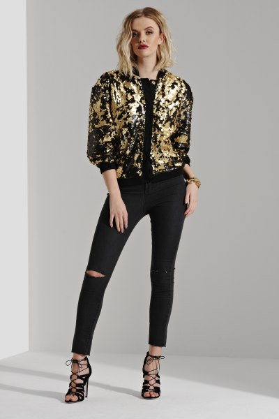 gold and black bomber jacket ripped skinny jeans