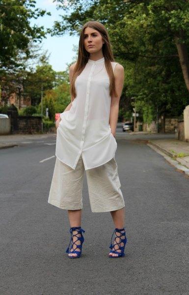 white sleeveless shirt dress over pale pink wide leg pants