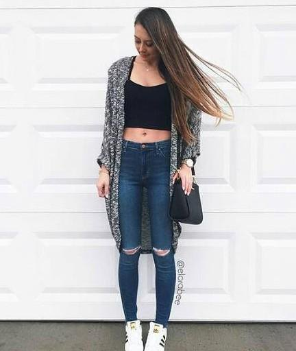light gray sculpture dark blue ripped skinny jeans