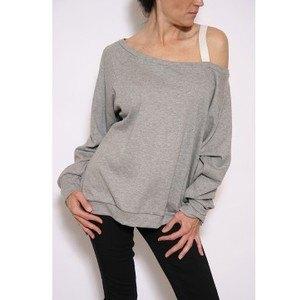 gray oversized shoulder sweater over white vest