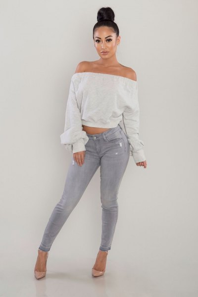 white off the shoulder cropped sweater gray skinny jeans