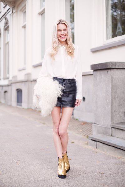 white shirt black mini leather skirt gold boots