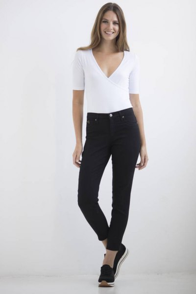 white deep v-neck top black ankle jeans