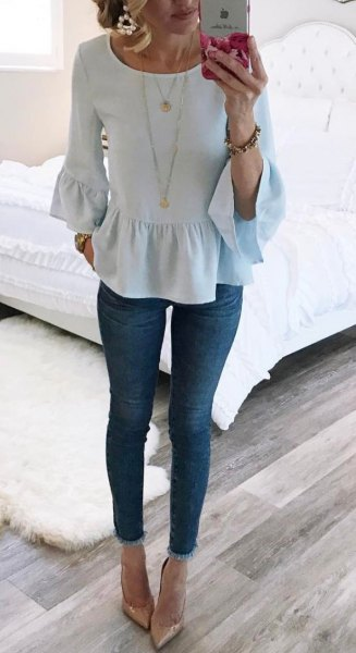 white bell sleeve ruffled blouse
