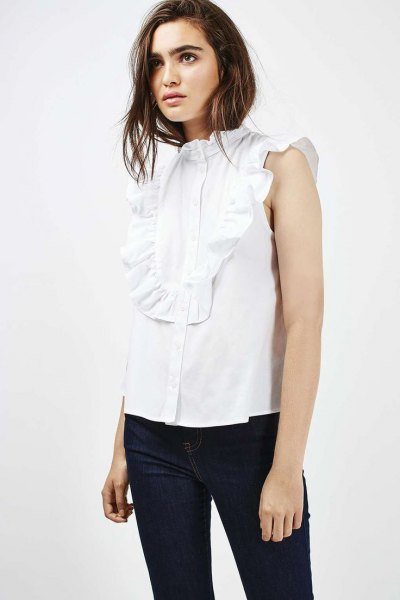 sleeveless white ruffle dark blue skinny jeans