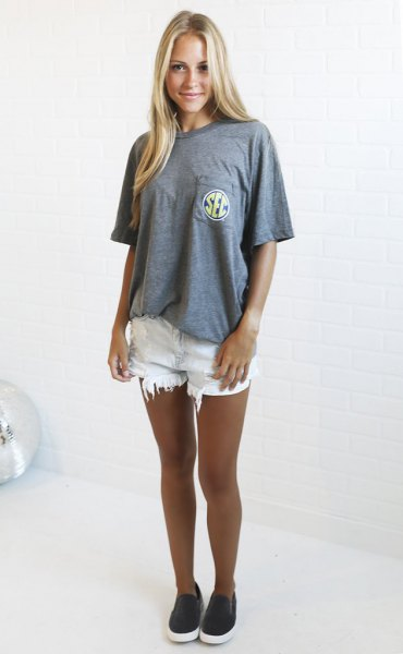 gray oversized t-shirt with white ripped denim shorts