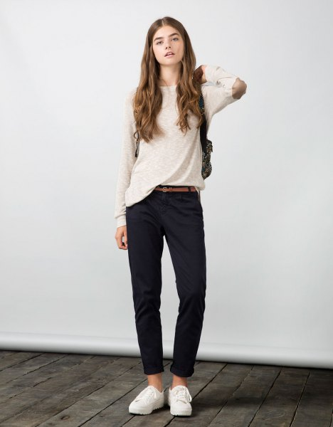 white elbow sweater with navy blue chinos