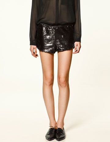 black chiffon semi sheer blouse sequin shorts