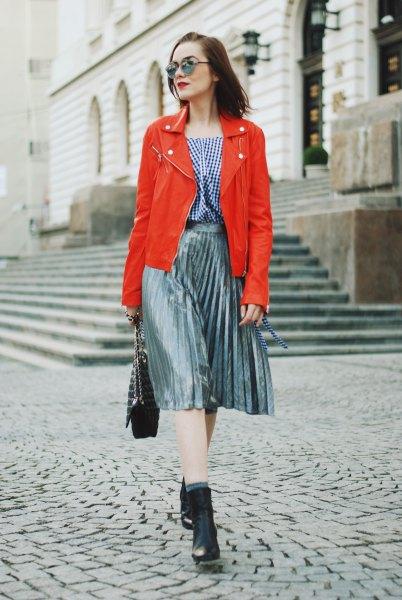 orange leather jacket silver pleated midi skirt