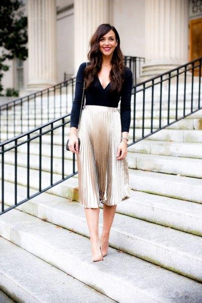 black deep v-neck long sleeve top silver metallic midi pleated skirt