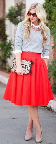 red skirt gray shirt cheetah bag