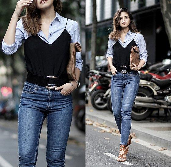 black silk camisole over light blue button up shirt