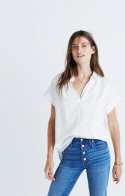 white oversized short sleeve shirt button skinny jeans
