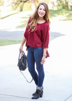 red jersey blouse in cuffed jeans