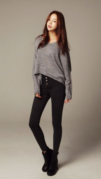gray long sleeved high slim tee black skinny jeans