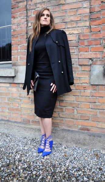 royal blue heels black coat draped over the shoulders