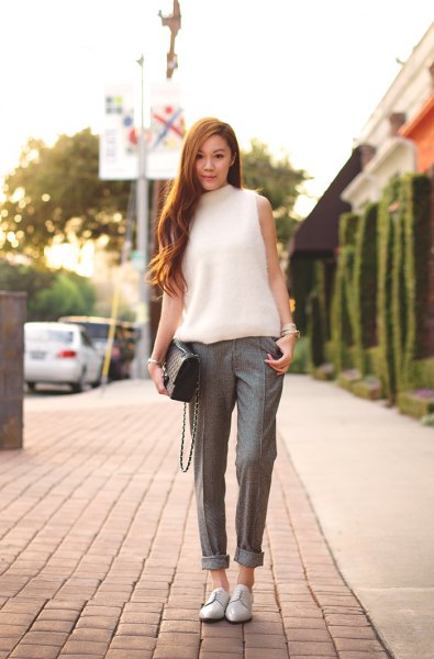 white mock neck sleeveless knit sweater cuffed tweed trousers