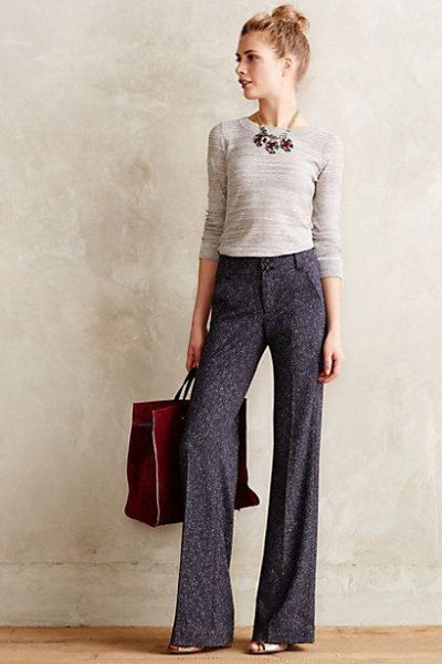 light pink form fitting sweater gray wide leg dress pants