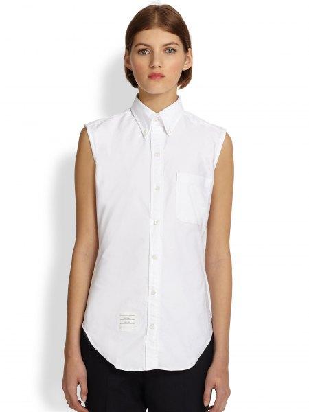 white sleeveless oxford shirt black pants