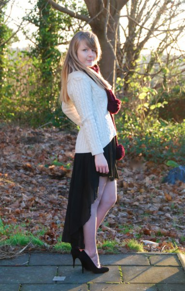 white cable knitted chunky sweater black high low skirt