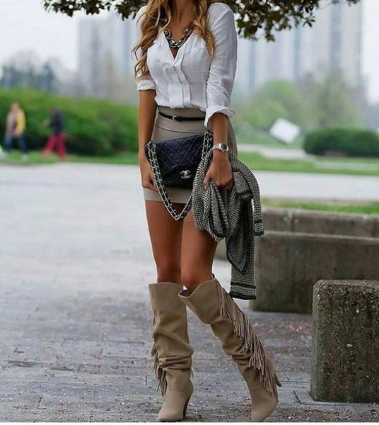 gray fringed knee high boots white shirt mini skirt