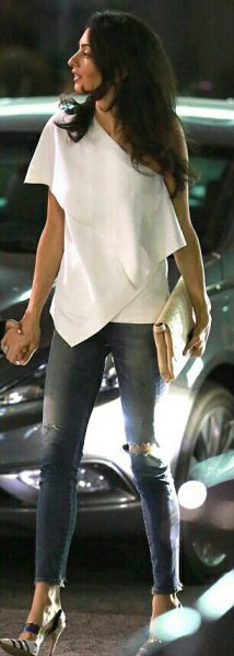 a shoulder-white draped top ripped skinny jeans