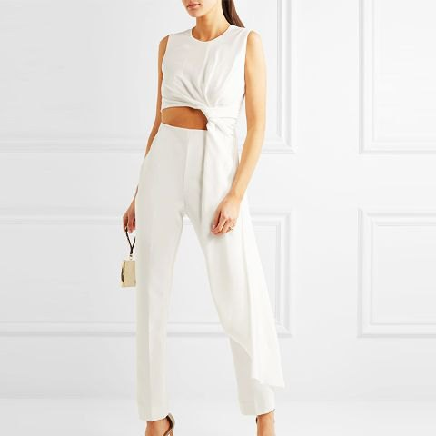 white asymmetrical cropped draped top