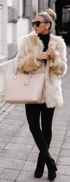 pink coat black mock neck sweater skinny jeans
