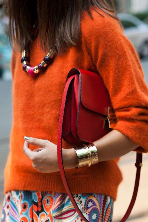 burnt orange sweater red