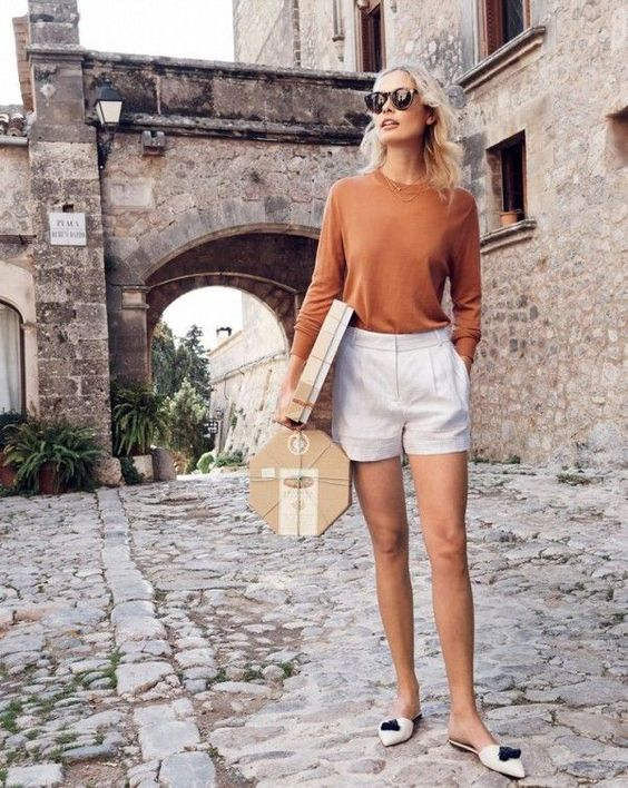 burnt orange sweater white shorts