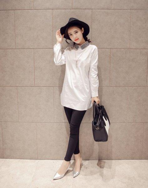 white long buttonless shirt black felt hat