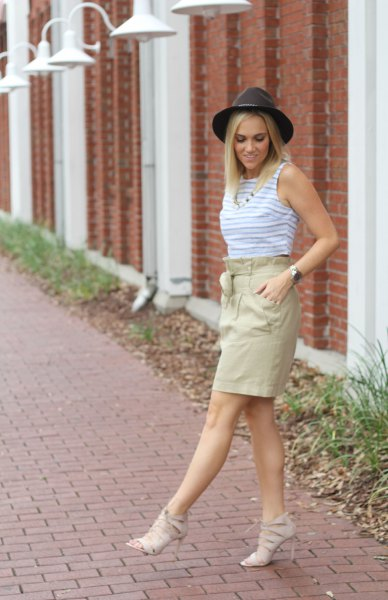blue top with high waist khaki skirt