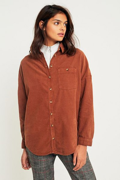 brown shirt over white sweater with hair loss