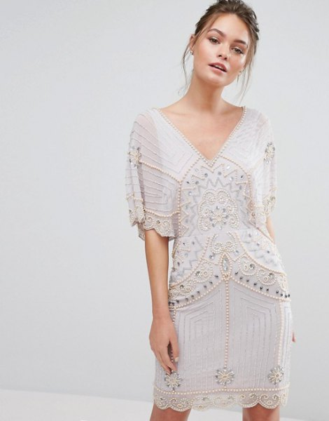 white batwing my dress gold sequin details