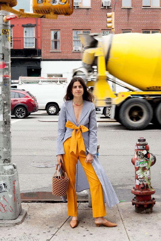 orange trousers gray tunic
