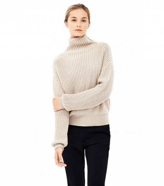 beige mock neck with ribbed sweater black skinny jeans
