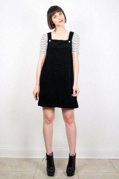 black overall dress striped t-shirt
