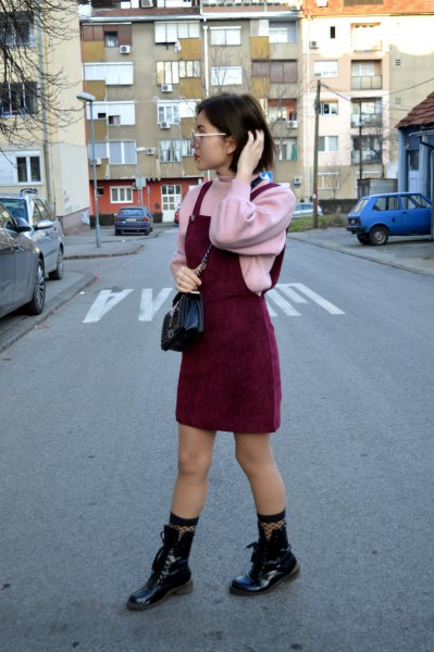 pink sweaters of leather boots