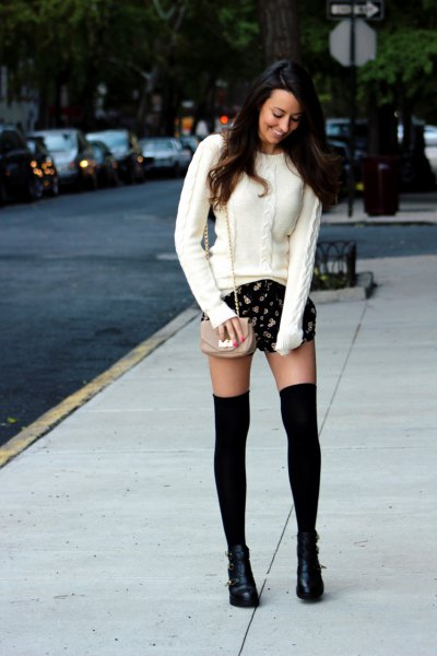 white cable knitted sweater black printed shorts